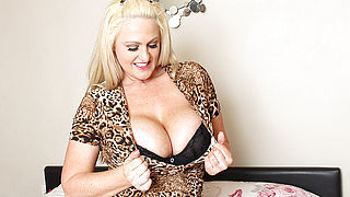 Big breasted British MILF playing with her pussy
