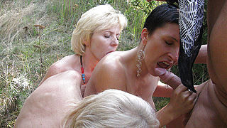 Kinky mature groupsex in the woods