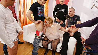 This kinky mama gets the cum of seven men in her face