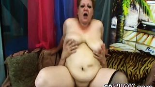 Big granny loves riding a young cock
