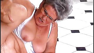 Mature lady with glasses has a hairy peach craving for some hard meat
